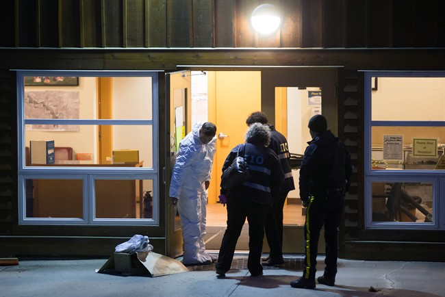 Investigators enter the Bridge River Indian Band office where one man died and nine others were injured following an attack, near Lillooet, B.C., on Wednesday October 14, 2015. A man suspected in a violent assault is dead and 10 others are hurt after an attack that reportedly involved a hammer.