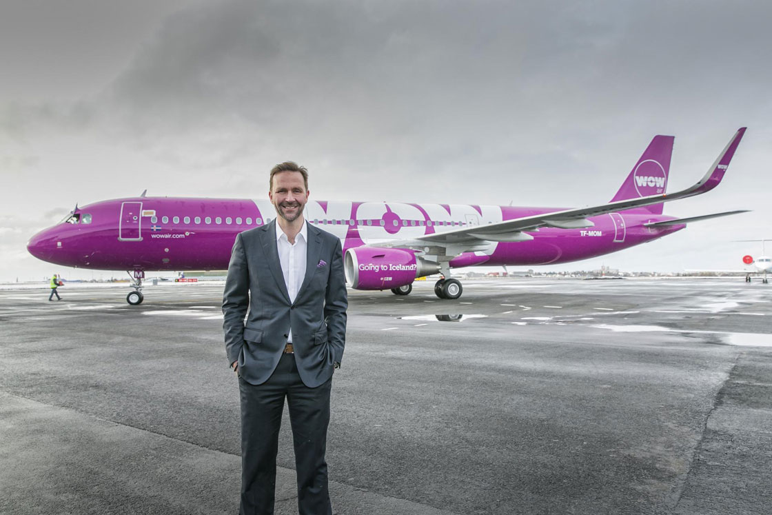 WOW Air chief Skuli Mogensen stands in front of one the airline's Airbus A321 aircraft.