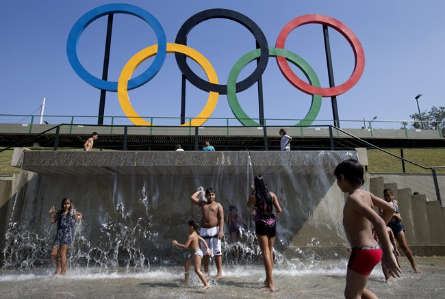 In this July 28, 2015 file photo, children play in a water fountain next to Olympic rings at Madureira Park in Rio de Janeiro, Brazil.