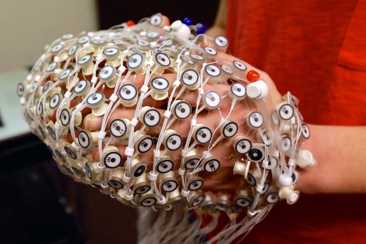 An EEG net for detecting brain activity is being prepared for use by research assistant Sara Mason at the University of Nebraska's Center for Brain, Biology and Behavior in Lincoln, Neb.