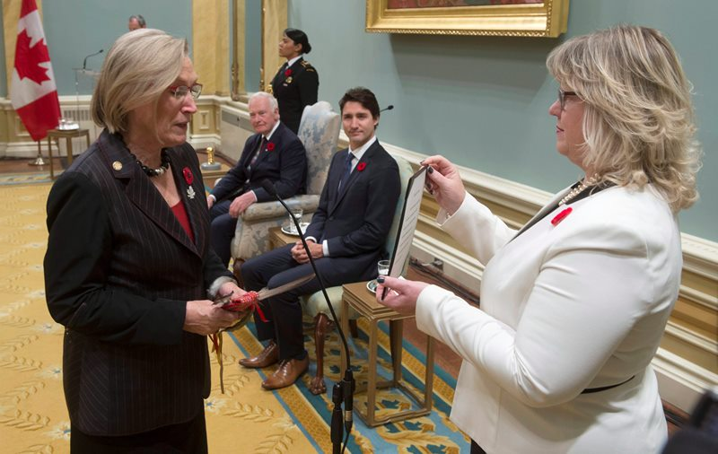 Governor General David Johnston and Prime Minister Justin Trudeau look on as Carolyn Bennett is sworn in as the Minister of Indigenous and Northern Affairs during ceremonies at Rideau Hall, Wednesday Nov.4, 2015 in Ottawa.