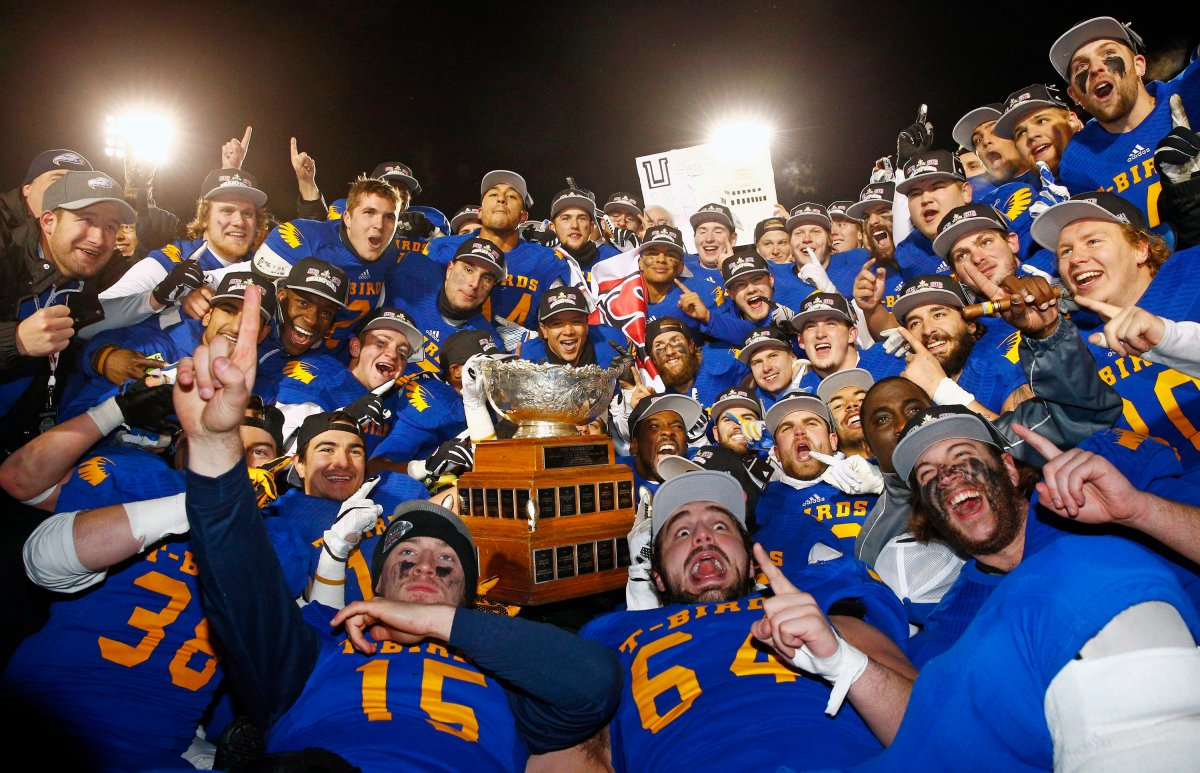 UBC Thunderbirds players celebrate after defeating the Montreal Carabins at the Vanier Cup Saturday, November 28, 2015 in Quebec City.