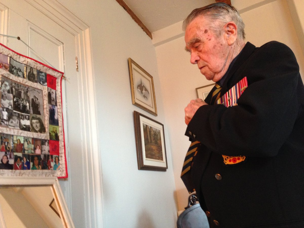 Veteran Rowland Marshall puts his suit and medals on ahead of a Remembrance Day service.