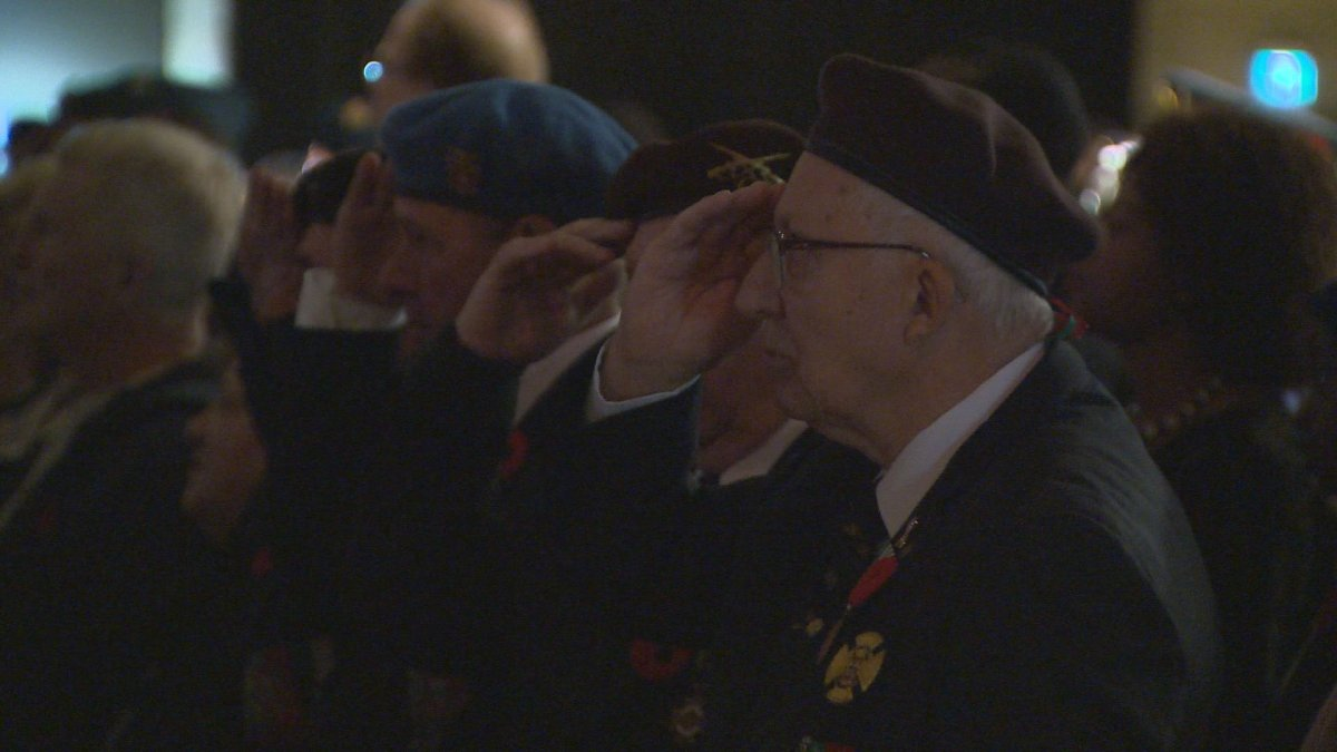 Veterans saluting during a Remembrance Day ceremony at the Convention Centre.