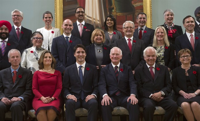 Governor General David Johnston (third from right) and Prime Minister Justin Trudeau (third from left) with members of Canada's first gender-equal cabinet, after they were sworn in in November 2015.