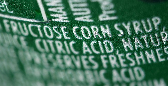 This Sept. 15, 2011 file photo shows a nutrition label that lists high fructose corn syrup as an ingredient in a can of soda.