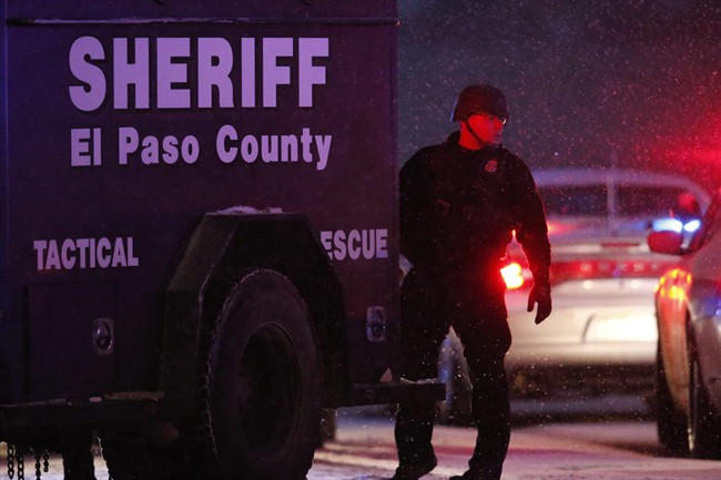 Police stand guard after a suspect was apprehended Friday, Nov. 27, 2015, in northwest Colorado Springs, Colo. A gunman opened fire at a Planned Parenthood clinic on Friday, authorities said, wounding multiple people.