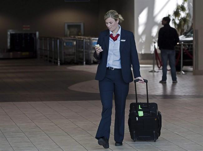 An Air Canada flight attendant walks through the terminal at the Halifax airport on Sept. 20, 2011.