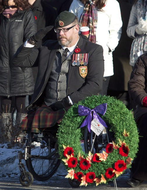 Veteran Paul Franklin, who lost both his legs in a suicide bombing in Kandahar, is shown saluting during the First Battalion Princess Patricia's Canadian Light Infantry Remembrance Day ceremony in Edmonton, Alberta, on Monday, November 11, 2013.