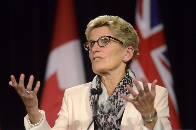 Ontario Premier Kathleen Wynne speaks during a media availability at Queen's Park in Toronto, Thursday, Oct, 1, 2015.