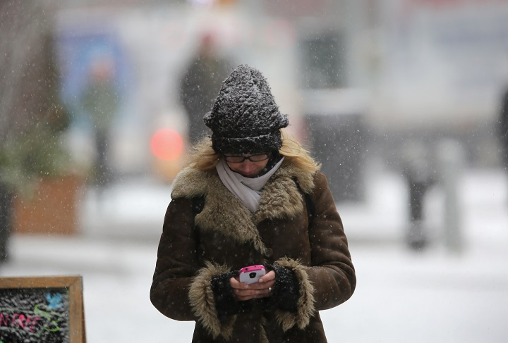 While it's a good idea to keep your head warm, it's more important that you keep your core heated.