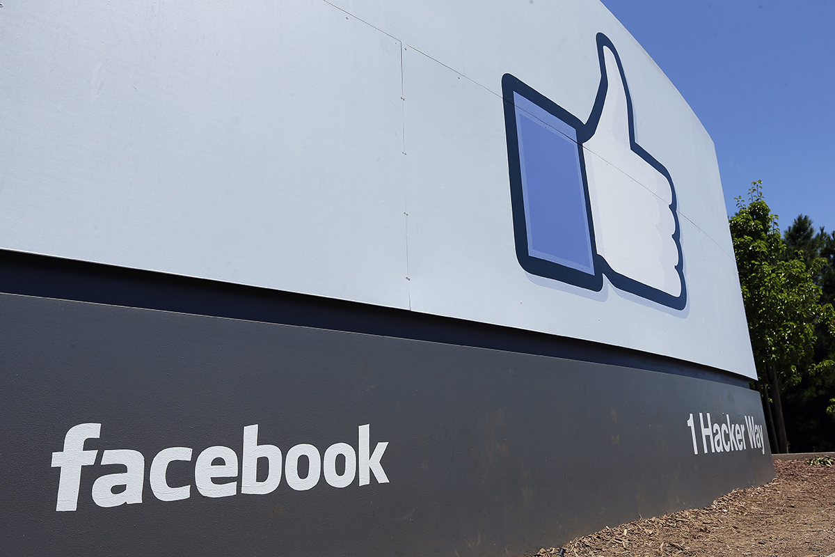 This file photo shows a sign at Facebook headquarters in Menlo Park, Calif.