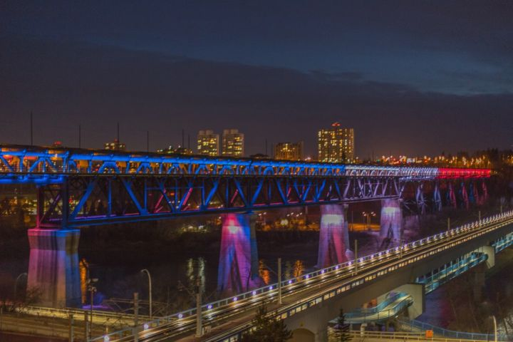 Edmonton's High Level Bridge lit up in blue, white and red lights to honour victims of Paris attacks.