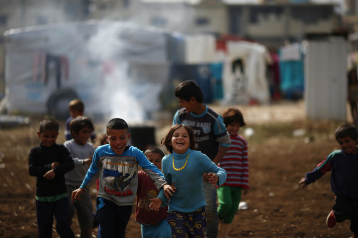 Syrian refugees play at a refugee camp in the town of Hosh Hareem, in the Bekaa valley, east Lebanon, Wednesday, October 28, 2015.