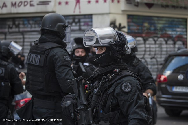 In this photo released Friday Nov. 20, 2015, by the French Interior Ministry, showing Police security forces during the raid in Saint-Denis region of Paris, France, on Wednesday Nov. 18 2015. Police raided a building in Saint-Denis area of Paris, on Wednesday Nov. 18, resulting in a shoot-out with fugitive Islamic extremists, following the attacks in Paris Friday Nov. 13.
