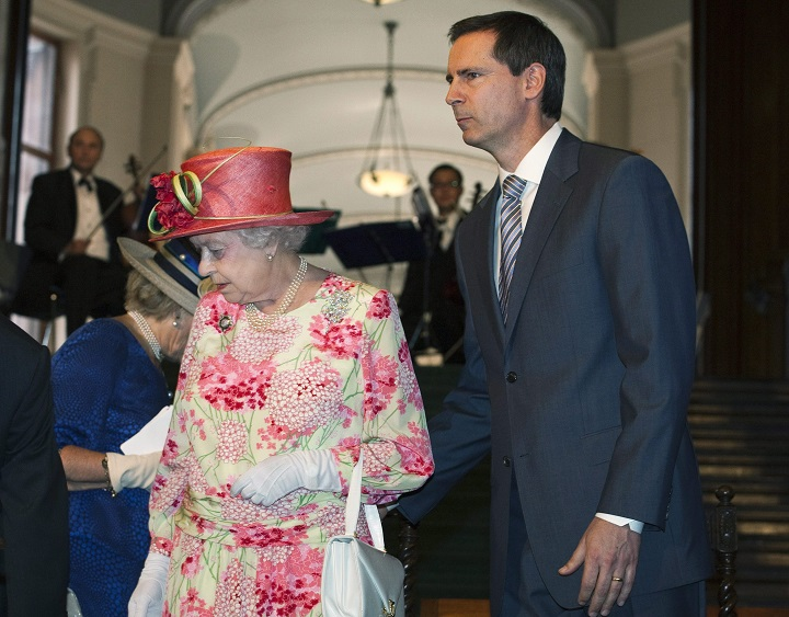Dalton McGuinty was warned not to crack jokes in the Queen's presence, but couldn't help himself. He also appears to touch the Queen in the photo above, another serious no-no.