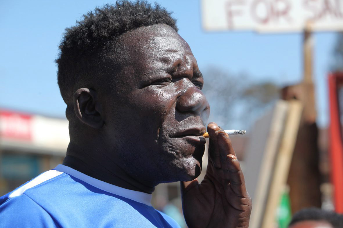 William Masvinu  is seen  working at a  Market in Mbare, Harare, in this June, 14, 2012 file photo.