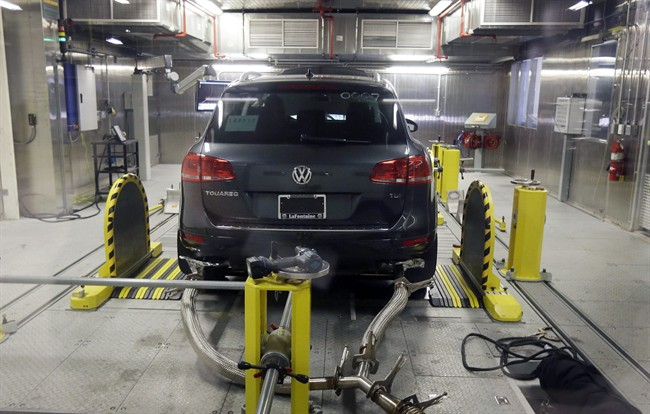 In this Oct. 13, 2015 file photo, a Volkswagen Touareg diesel is tested in the Environmental Protection Agency's cold temperature test facility in Ann Arbor, Mich.