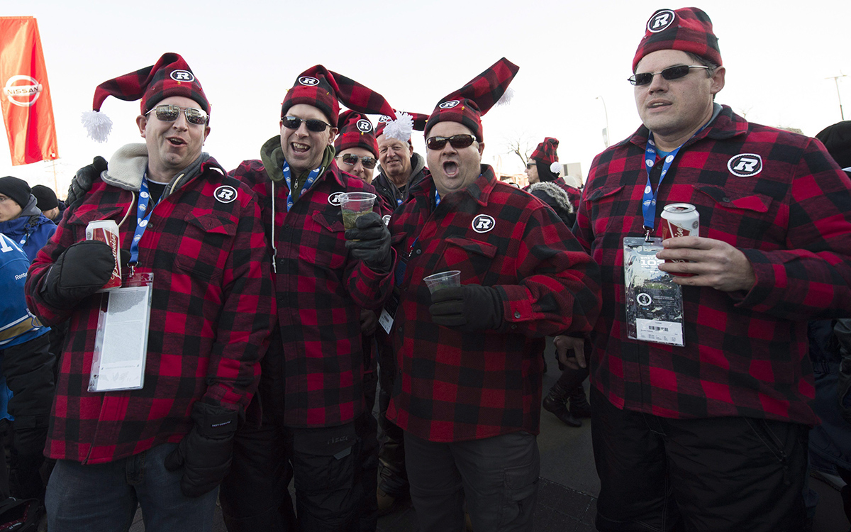 Football fans are seen prior to the 103rd Grey Cup between the Edmonton Eskimos and the Ottawa Redblacks in Winnipeg, Man., on Sunday, Nov. 29, 2015.