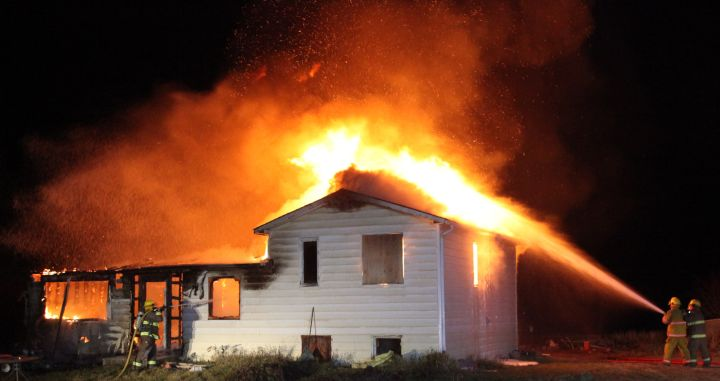 Fire crews battle a house fire in Rimbey, Alberta Tuesday, Nov. 10, 2015.