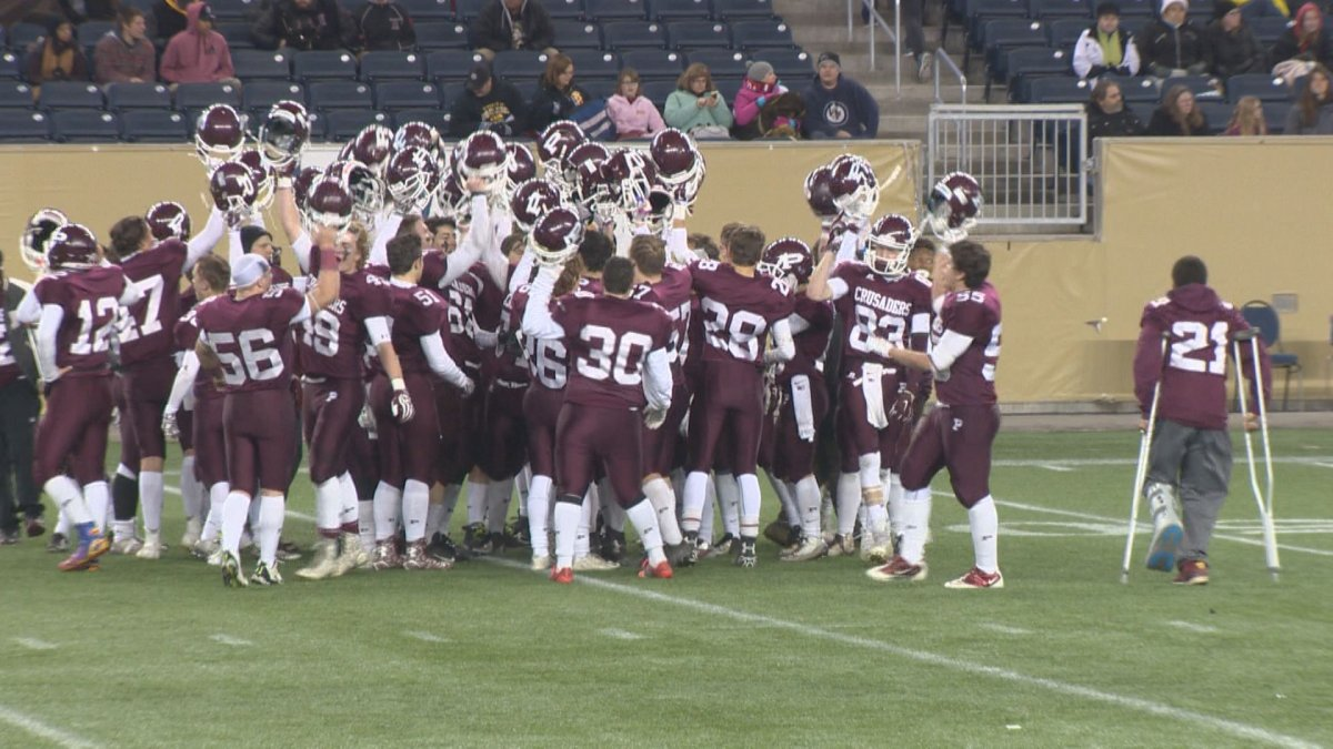 The St. Paul's Crusaders celebrate a 52-14 victory over the Garden City Fighting Gophers in the WHSFL semifinal.