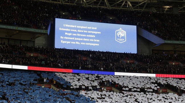 Words from the French national anthem are displayed on a big screen before the international friendly soccer match between England and France at Wembley Stadium in London, Tuesday, Nov. 17, 2015.