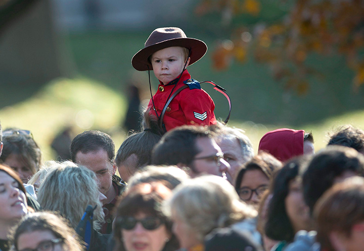 A youngster wearing a Mountie uniform is pictured at Ottawa's Rideau Hall on Nov. 4, 2015.