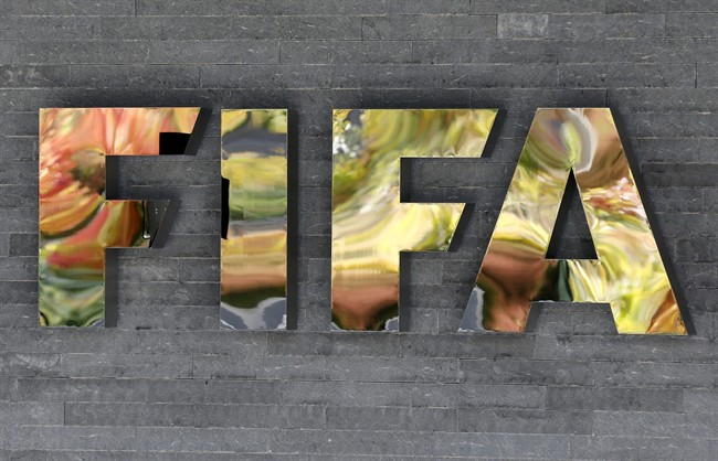 In this Sept. 25, 2015 file picture the FIFA logo is pictured on a wall of the FIFA headquarters in Zurich, Switzerland.