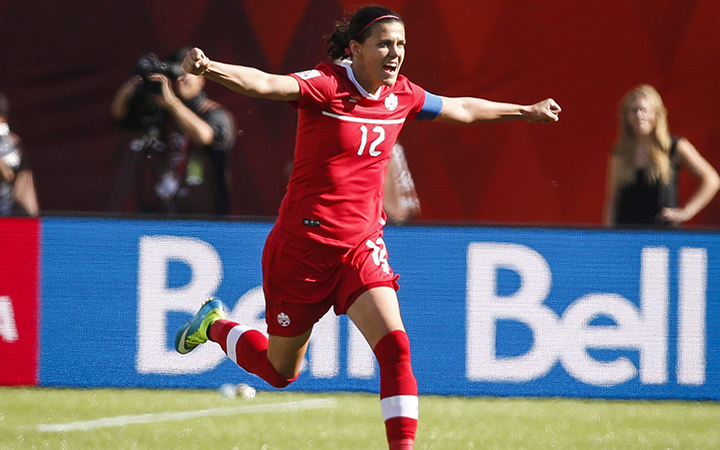 Canada's Christine Sinclair celebrates her game-winning stoppage-time penalty shot goal against China during FIFA Women's World Cup soccer action in Edmonton, Alta., Saturday, June 6, 2015.