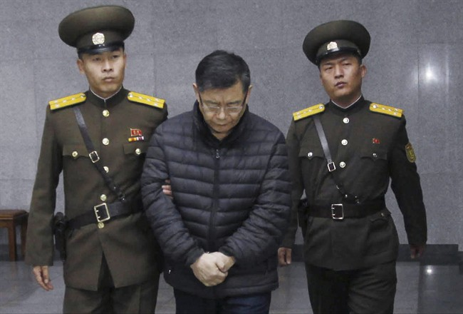 Hyeon Soo Lim, center, who pastors the Light Korean Presbyterian Church in Toronto, is escorted to his sentencing in Pyongyang, North Korea, Wednesday, Dec. 16, 2015. North Korea's Supreme Court sentenced a Canadian pastor to life in prison with hard labor on Wednesday for what it called crimes against the state.