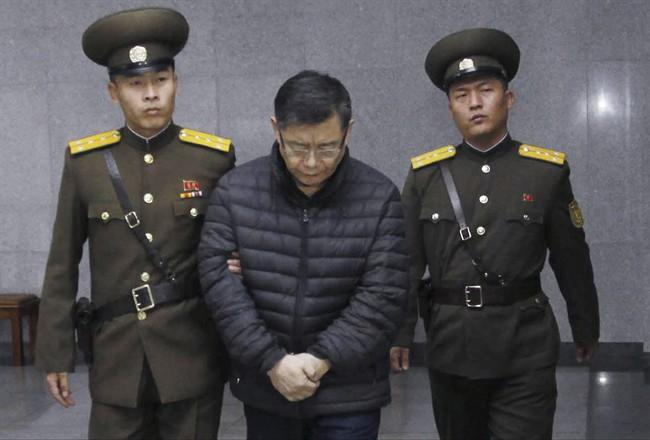 Hyeon Soo Lim, center, who pastors the Light Korean Presbyterian Church in Toronto, is escorted to his sentencing in Pyongyang, North Korea, Wednesday, Dec. 16, 2015.