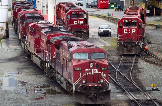 A Canadian Pacific Rail maintenance worker climbs onto a locomotive at the company's Port Coquitlam yard east of Vancouver, B.C., on Wednesday May 23, 2012.