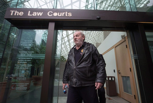 Ivan Henry,leaves B.C. Supreme Court during a lunch break in Vancouver, B.C., on Monday August 31, 2015. The lawyer of a man wrongfully imprisoned for 27 years says her client's 1983 sexual-assault trial is Canada's most egregious example of the Crown withholding evidence.