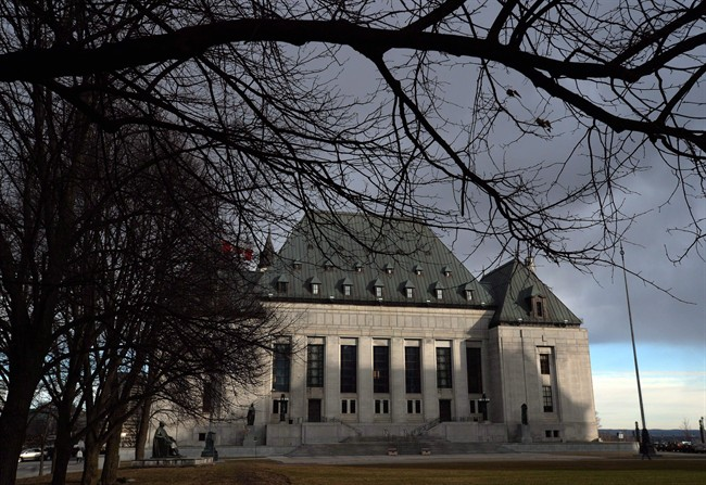 The Supreme Court of Canada building is shown in Ottawa on April 14, 2015. An oral hearing will be held next month at the Supreme Court as it considers whether to approve the federal government's request for an extension in response to its ruling on doctor-assisted death. THE CANADIAN PRESS/Sean Kilpatrick.