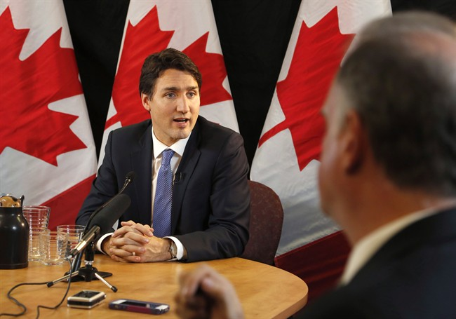 Prime Minister Justin Trudeau speaks with reporters during an interview with The Canadian Press in Ottawa on Wednesday, December 16, 2015. Ensuring Canadians have access to federal information will mean more — and sometimes difficult — public scrutiny, but ultimately it will lead to better government, the prime minister says.