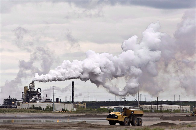 A dump truck works near the Syncrude oil sands extraction facility near the city of Fort McMurray, Alta.