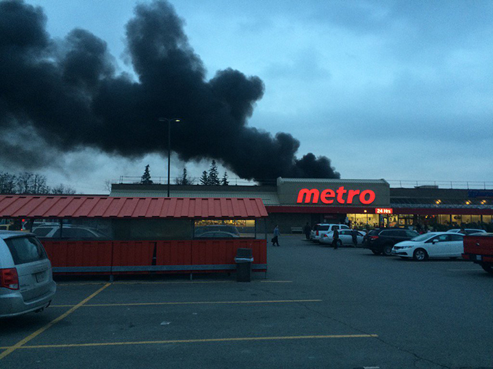 Firefighters evacuated a Tim Hortons and Metro grocery store after a truck fire on Dec. 8, 2015.