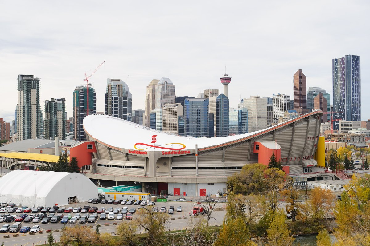 A general view of the exterior of the Scotiabank Saddledome on Oct. 6, 2013, with the Calgary skyline behind.