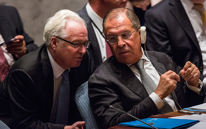 Sergey Lavrov (R), Foreign Minister of Russia, speaks to Vitaly Churkin, Russian Permanent Representative to the United Nations at a U.N. Security Council meeting on September 30, 2015 in New York City.