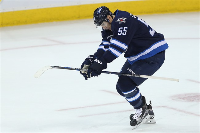 Winnipeg Jets' Mark Scheifele (55) celebrates his overtime winning goal against Washington Capitals goaltender Braden Holtby.