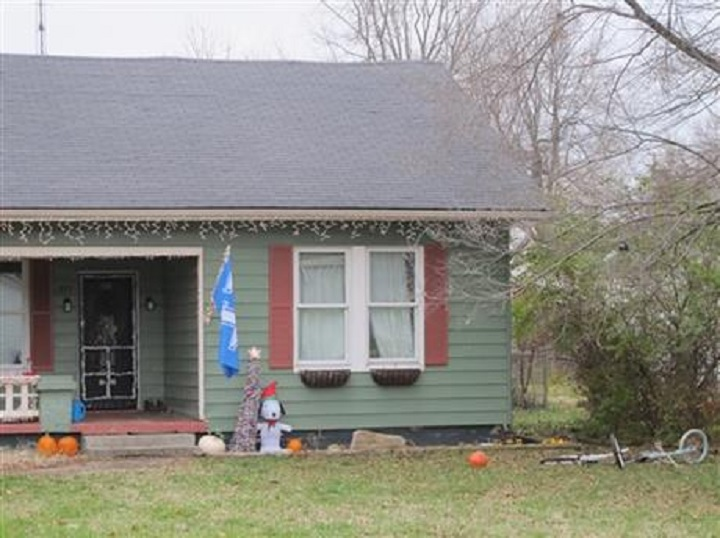 Christmas decorations adorn the house in Versailles, Ky., where a 6-year-old boy was killed during a break in Monday, Dec. 7, 2015. Police say a stranger from Indiana broke into the home and stabbed the boy multiple times. (AP Photo/Bruce Schreiner).