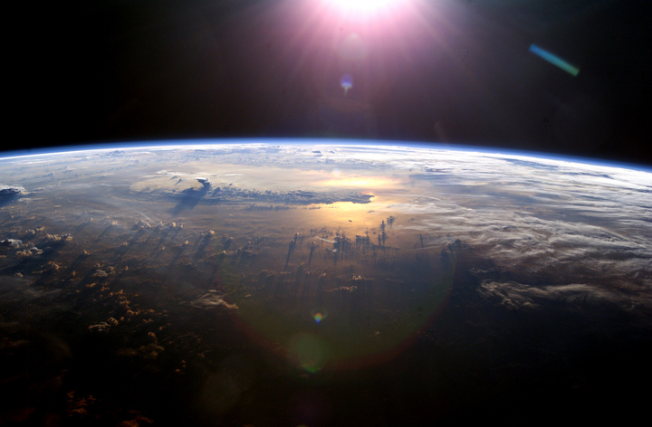 The sun illuminates Earth as seen from the International Space Station.