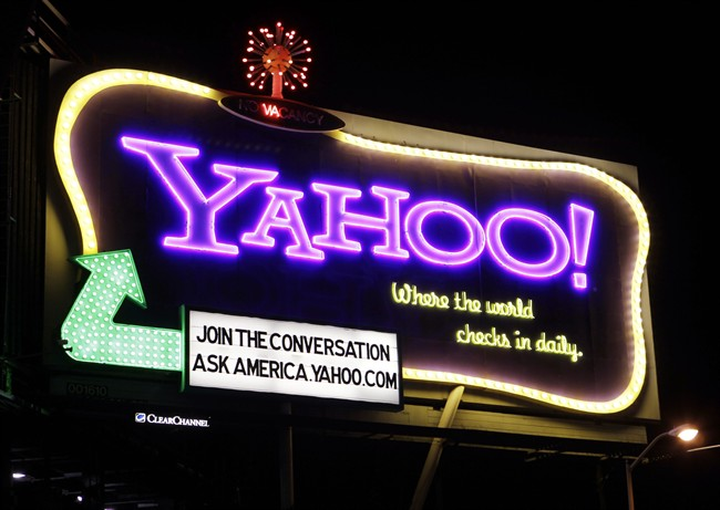 In this Oct. 4, 2010 file photo, a Yahoo signboard is displayed in San Francisco. Shares of Yahoo are up sharply before the opening bell, Wednesday, Dec. 2, 2015, on a report that the company will discuss the sale of its Internet business. (AP Photo/Paul Sakuma).