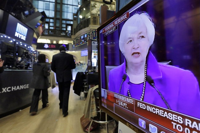 Federal Reserve Chair Janet Yellen's Washington news conference is shown on a television screen on the floor of the New York Stock Exchange, Wednesday, Dec. 16, 2015. The Fed's move to lift its key rate by a quarter-point to a range of 0.25 percent to 0.5 percent ends an extraordinary seven-year period of near-zero rates that began at the depths of the 2008 financial crisis.