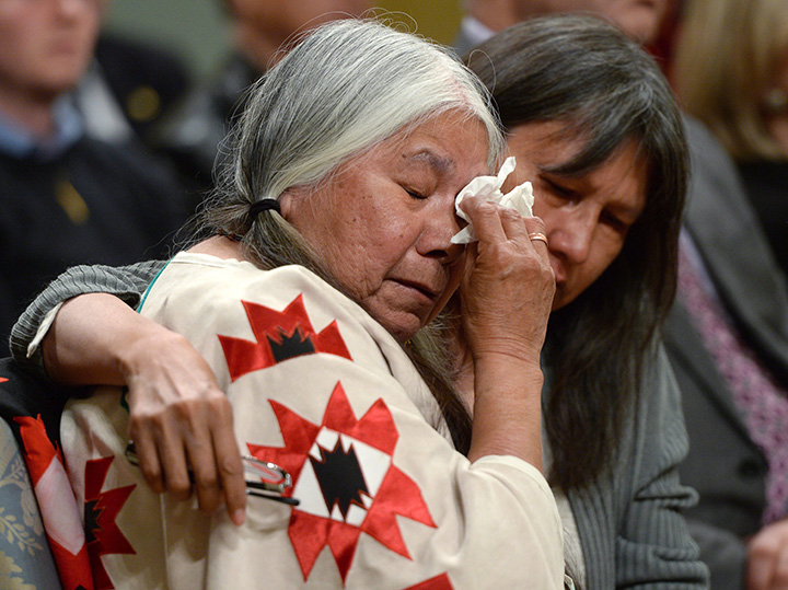 Residential school survivor Lorna Standingready is comforted by a fellow survivor during the closing ceremony of the Indian Residential Schools Truth and Reconciliation Commission, at Rideau Hall in Ottawa on Wednesday, June 3, 2015.