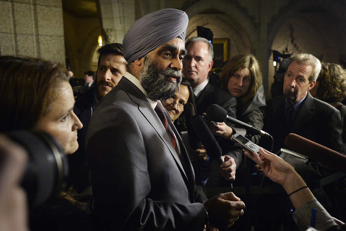 Defence Minister Harjit Sajjan scrums with media in Ottawa on Monday.