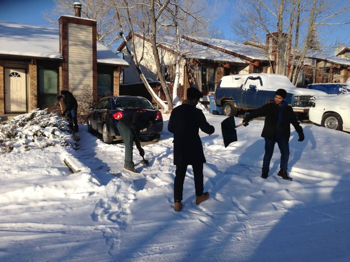 Calgary's Islamic Centre arranged for its members to help shovel driveways to spread some holiday cheer for a white Christmas in the city.