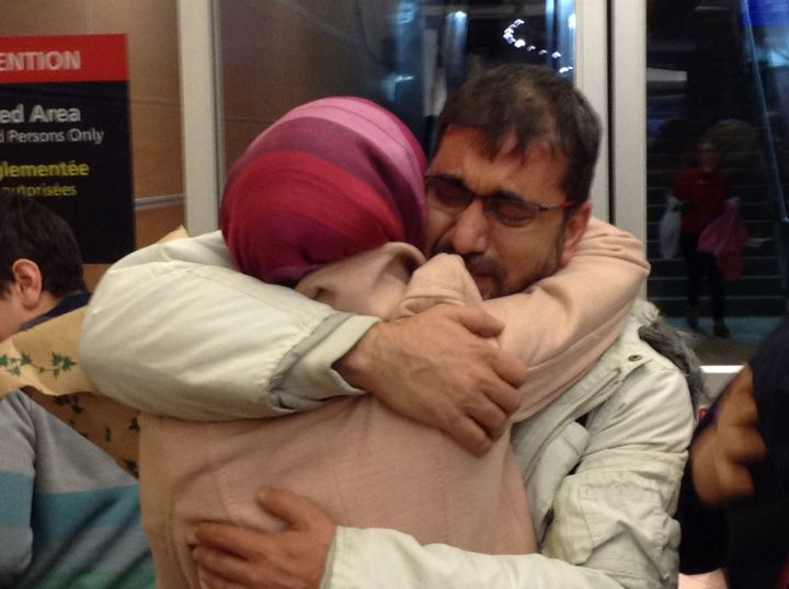 A niece hugs her uncle for the first time in five years at the Edmonton International Airport as another family of Syrian refugees arrives in Alberta's capital ahead of many more expected by March, 2016.