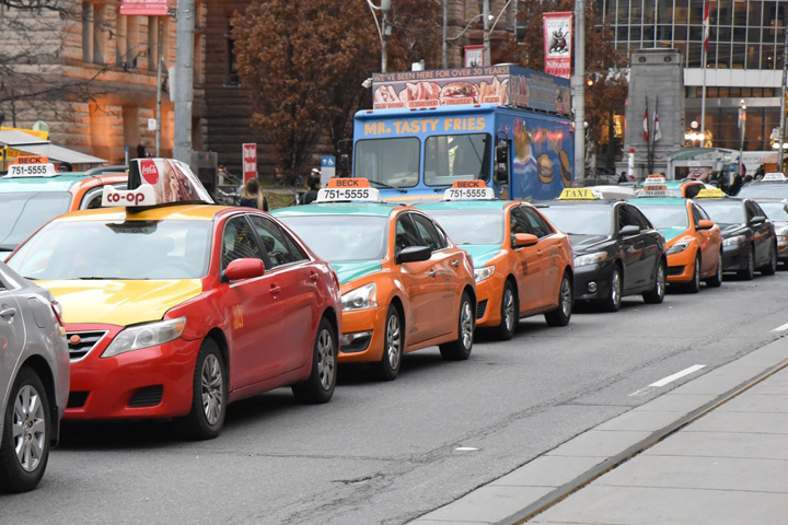 Toronto taxi drivers brought city traffic to a standstill in a massive anti-Uber protest on December 9.