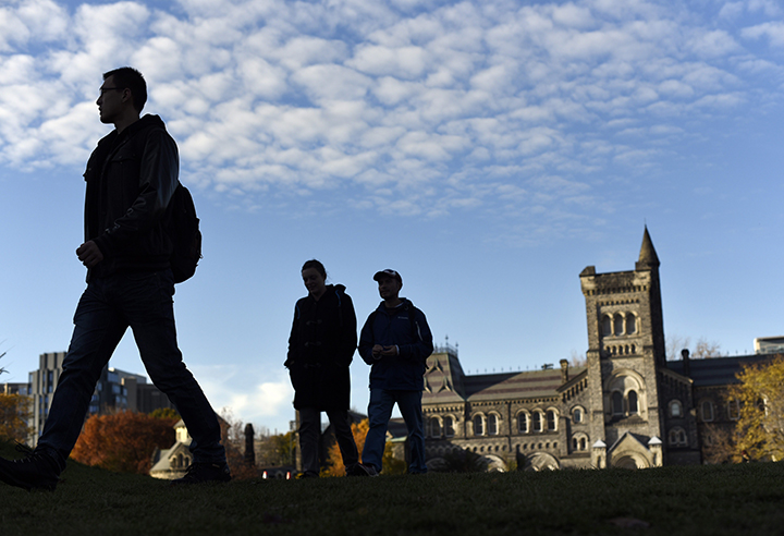 Students cross the front campus at the University of Toronto's downtown campus on Nov 2 2015.